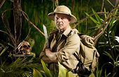 pic of machete  - Adventurer with colonial style survival equipment in the jungle with skull - JPG