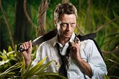 pic of machete  - Attractive confident businessman with machete walking in the jungle - JPG