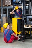 stock photo of unsafe  - Vertical view of an accident on a forklift - JPG