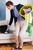 foto of superwoman  - Vertical view of a young businesswoman doing the housework - JPG