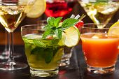 foto of cocktail  - Party cocktails and longdrinks garnished with fruits for summer - JPG