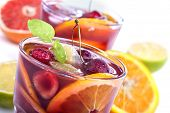 picture of sangria  - Sangria with citrus and other fruit on a white background - JPG