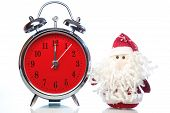 picture of father time  - Santa Claus or Father Frost and vintage alarm clock with red dial on white background with reflection - JPG