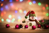 foto of snowman  - Christmas background with Christmas tree and snowman on a rustic wooden board - JPG