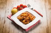 stock photo of swordfish  - spaghetti with swordfish ragout and lemon peel - JPG