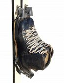 stock photo of ski boots  - Old ski boots in black with white laces isolated on white background - JPG