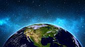 stock photo of planet earth  - Planet Earth in universe or space - JPG