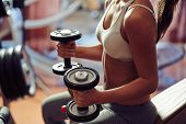 stock photo of lifting weight  - Young woman exercising with weights - JPG