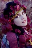 pic of pixie  - beautiful brunette in autumn red leaves looking like pixie - JPG