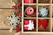 picture of crate  - Beautiful Christmas composition with gifts in wooden crate - JPG