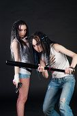 stock photo of gun shot wound  - two girls with weapon on black background - JPG