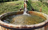 picture of washtub  - Wooden, flowing water tanks. Decoration garden irrigation.