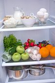 pic of water cabbage  - Refrigerator full of food water in bottles - JPG