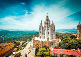 image of crucifixion  - Tibidabo church on mountain in Barcelona with christ statue overviewing the city - JPG