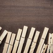 pic of pegging  - wooden clothes pegs on the brown table - JPG