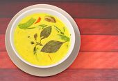 foto of curry chicken  - Hot and spicy chicken green curry on a wood table top - JPG
