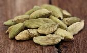 picture of cardamom  - Clsoe up o some Cardamom seed on wooden surface - JPG