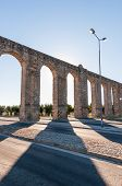 picture of aqueduct  - Ancient Roman aqueduct in Evora in afternoon sun Portugal - JPG
