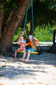 image of tire swing  - Kids having fun on swing on summer day - JPG