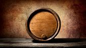 picture of keg  - Barrel on a wooden table and brown background - JPG