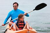 picture of kayak  - Father and daughter kayaking at tropical ocean on summer vacation - JPG