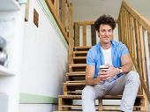 image of breather  - Man sitting with a mug on the stairs - JPG