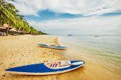 foto of kayak  - Kayaks at the tropical beach at Phu Quoc island  in Vietnam - JPG