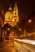 stock photo of saint-nicolas  - Prague street with Saint Nicolas church - JPG