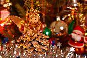foto of christmas angel  - Shining lights and angel on the Christmas tree - JPG