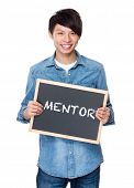 foto of mentoring  - Asian young man with chalkboard showing a word mentor - JPG