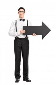 stock photo of bow arrow  - Full length portrait of a elegant young man with black bow - JPG