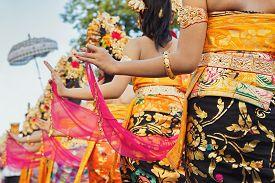 stock photo of garuda  - Group of beautiful Balinese girls in bright traditional costumes  - JPG