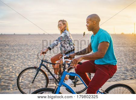 happy couple riding bikes at