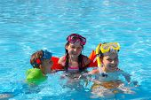 pic of children playing  - Happy kids playing and having fun together in the pool - JPG