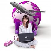 Young woman using a laptop with the Earth a pile of luggage and an airplane at the background