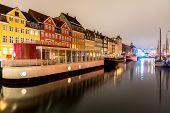 Copenhagen Nyhavn, New port of Copenhagen, at night in Denmark poster