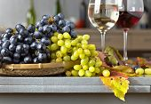 Ripe Juicy Grape And Glass Of Wine poster