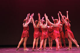 stock photo of ballet dancer  - Modern Dance group in Red costumes on stage - JPG