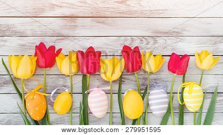 poster of Easter Eggs And Tulips. Happy Easter Card With Copy Space. Colorful Easter Eggs Among Fresh Spring T