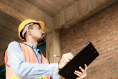 Engineer Or Inspector Checking Progressing Work In Construction Site poster