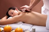 Therapist Giving Back Massage To Young Woman poster