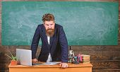 Teacher Strict Serious Bearded Man Lean On Table Chalkboard Background. Teacher Looks Threatening. R poster