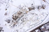Aerial Top View Of Construction Site In Winter. Building Of New Residential Area, Tower Cranes And M poster