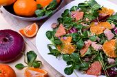 Salad With Radicchio, Mandarins, Red Oranges And Canned Tuna On A White Plate poster