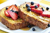 stock photo of french-toast  - Breakfast of french toast with fresh berries and maple syrup - JPG