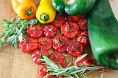 stock photo of poblano  - Compilation of poblano pepper, scotch bonnet, miniature bell peppers, fresh rosemary, oregano ** Note: Shallow depth of field - JPG