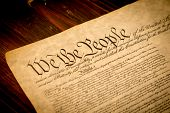 picture of preamble  - The Constitution of the United States of America on a wooden desk - JPG