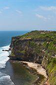 picture of dua  - Cliffs above blue tropical sea on Nusa Dua Bali Indonesia - JPG