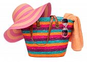 Colorful Striped Beach Bag With A Straw Hat Towel And Sunglasses