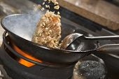 pic of chinese wok  - Closeup of fried rice being cooked in wok - JPG